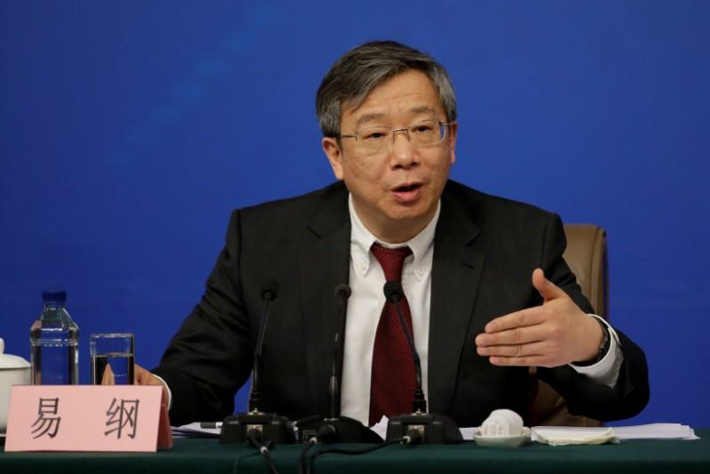 Yi Gang, deputy central bank governor of the People's Bank of China, attends a news conference in Beijing