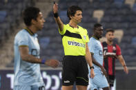 Referee Sapir Berman works during an Israeli Premier League soccer match between Hapoel Haifa and Beitar Jerusalem in the northern Israeli city of Haifa, Monday, May 3, 2021. Israeli soccer's first transgender soccer referee took the field Monday for the first time since coming out publicly as a woman last week. (AP Photo/Sebastian Scheiner)