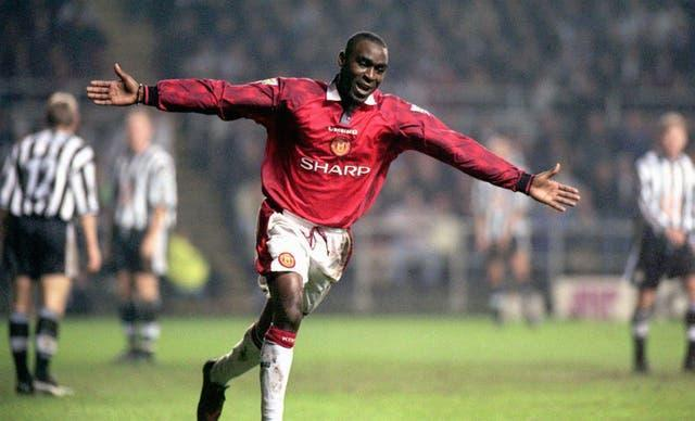 Andrew Cole celebrates scoring for Manchester United