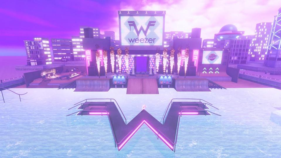 """A wintry realm with a big W in the snow below a big screen displaying """"Weezer."""""""