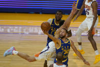 Golden State Warriors guard Stephen Curry (30) shoots against Phoenix Suns guard Devin Booker during the second half of an NBA basketball game in San Francisco, Tuesday, May 11, 2021. (AP Photo/Jeff Chiu)