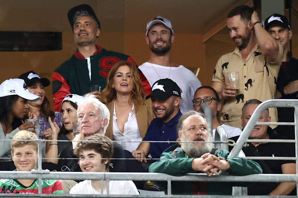 Taika Waititi, Chris Hemsworth, Sabrina Elba, Elsa Pataky, Isla Fisher and Russell Crowe watch the round three NRL match between the South Sydney Rabbitohs and the Sydney Roosters at Stadium Australia on March 26, 2021, in Sydney, Australia. (Photo by Cameron Spencer/Getty Images)