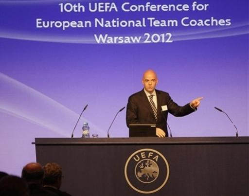 UEFA Secretary General Gianni Infantino addresses national football team coaches from some 50 European nations at the start of their two-day meeting in Warsaw, Poland, on Monday, Sept. 24, 2012. Poland co-hosted the EURO 2012 football championship in June. (AP Photo/Czarek Sokolowski)