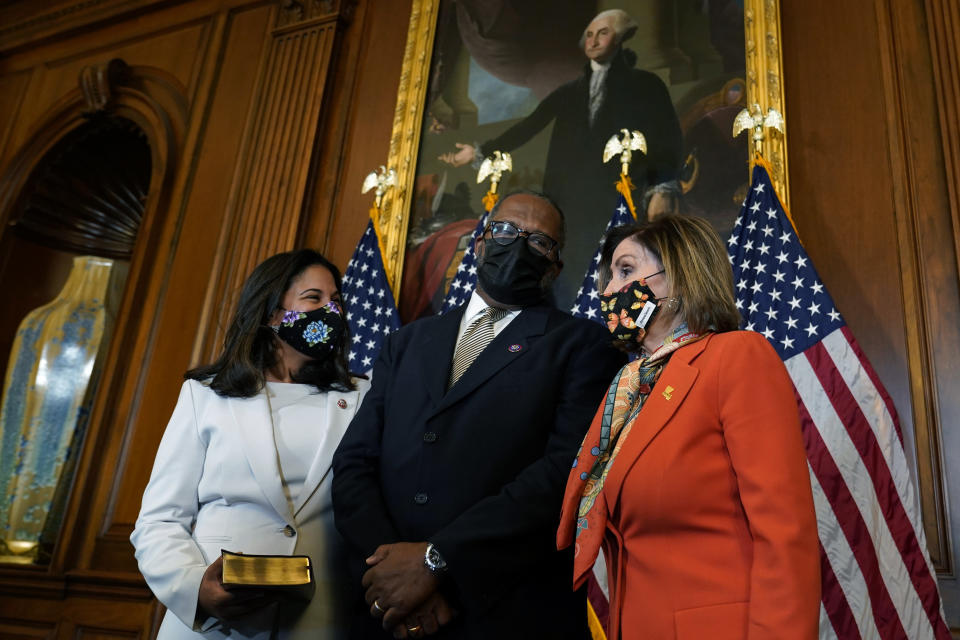 House Speaker Nancy Pelosi of Calif., right, poses for a photo during a ceremonial swearing-in for Rep. Troy Carter, D-La., center, as his wife Ana Carter, left, watches on Capitol Hill in Washington, Tuesday, May 11, 2021. (AP Photo/Susan Walsh)