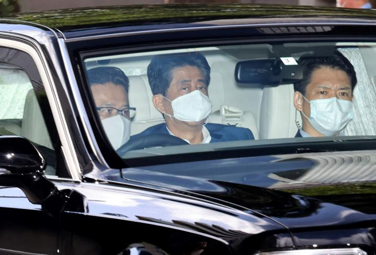 Japan PM in hospital for more checks as health speculation grows