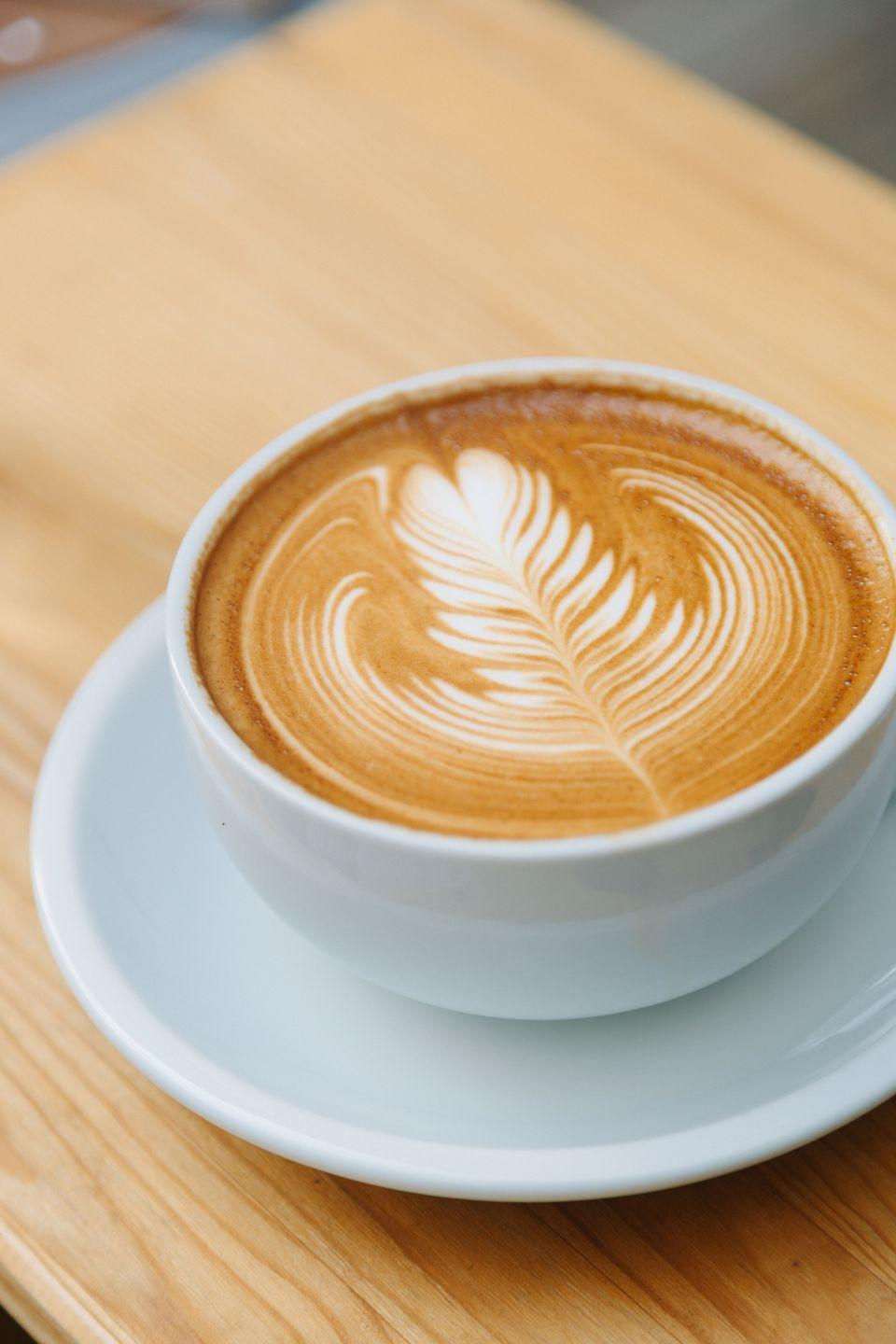 """<p>This is the one exception to the whole """"don't drink your calories at breakfast"""" rule. By making a large (16 ounces and up) latte a part of your breakfast, you're getting around 13 grams of protein! It's a great solution when you're pinched for time. Since milk is 80% water but also contains minerals such as calcium and <a href=""""https://www.goodhousekeeping.com/health/diet-nutrition/g2065/potassium-superfoods/"""" rel=""""nofollow noopener"""" target=""""_blank"""" data-ylk=""""slk:potassium"""" class=""""link rapid-noclick-resp"""">potassium</a>, it can help you hydrate with both fluid <em>and </em>electrolytes. Skip flavored syrups, sugar, caramel, or deceptive calorie bombs in pre-sweetened drinks. Choose <a href=""""https://www.goodhousekeeping.com/health/diet-nutrition/g20975587/healthy-starbucks-drinks/"""" rel=""""nofollow noopener"""" target=""""_blank"""" data-ylk=""""slk:coffee-based beverages"""" class=""""link rapid-noclick-resp"""">coffee<em>-</em>based beverages</a> like café au laits, lattes, or mistos with low-fat milk or unsweetened <a href=""""https://www.goodhousekeeping.com/health/diet-nutrition/g27128821/best-milk-alternative-substitutes/"""" rel=""""nofollow noopener"""" target=""""_blank"""" data-ylk=""""slk:plant-based alternatives"""" class=""""link rapid-noclick-resp"""">plant-based alternatives</a>, like soy milk. </p>"""