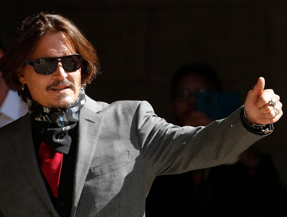 Johnny Depp arrives at the High Court in London, Tuesday, July 21, 2020.