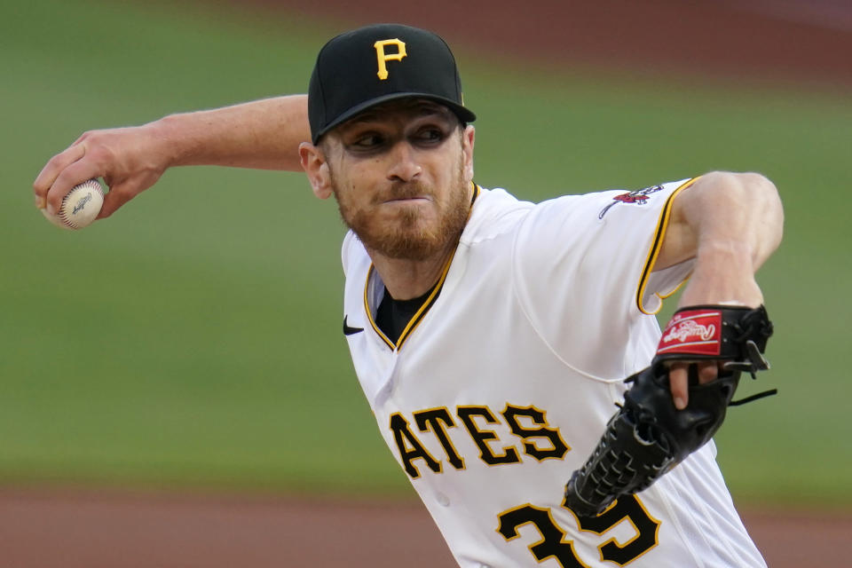 Pittsburgh Pirates starting pitcher Chad Kuhl delivers during the first inning of a baseball game against the San Diego Padres in Pittsburgh, Tuesday, April 13, 2021. (AP Photo/Gene J. Puskar)