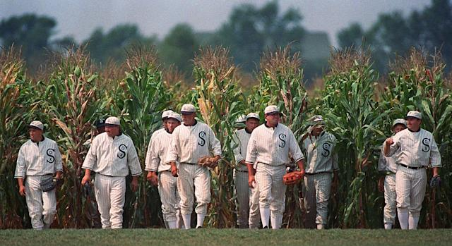 "Ghost Players emerge from the cornfield at the ""Field of Dreams"" movie site in Dyersville, Iowa. (AP Photo/Charlie Neibergall)"
