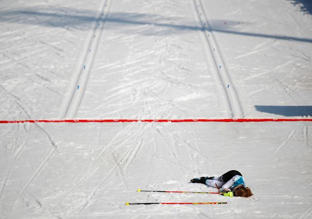 Biathlon - Pyeongchang 2018 Winter Paralympics - Women's 10km - Visually Impaired - Alpensia Biathlon Centre - Pyeongchang, South Korea - March 13, 2018 - Clara Klug of Germany collapses in the snow after crossing the finish line in third place. REUTERS/Carl Recine