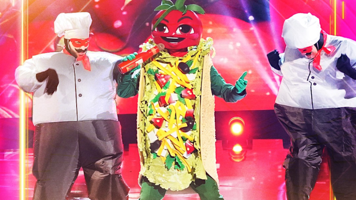 Yes, that's a taco singing into a bottle of ketchup.