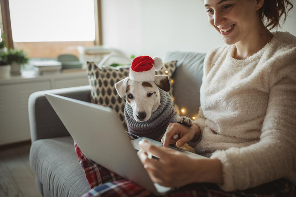 Paying strictly cash for holiday expenses won't be the most feasible strategy in 2020 when shoppers are poised to rely more than ever on online transactions. (Photo: Getty)