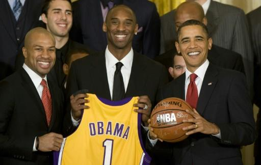 In this file photo taken on January 25, 2010 US President Barack Obama poses with Los Angeles Lakers' Derek Fisher and Kobe Bryant
