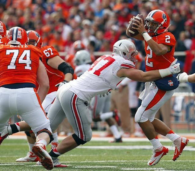 Illinois quarterback Nathan Scheelhaase (2) is sacked by Ohio State defensive lineman Joey Bosa (97) during the first half of an NCAA college football game on Saturday, Nov. 16, 2013, in Champaign, Ill. (AP Photo/Jeff Haynes)