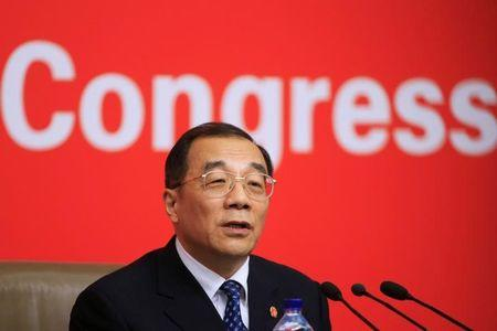 China's Minister of Supervision, and Chief of the National Bureau of Corruption Prevention, Yang Xiaodu attends a news conference during the 19th National Congress of the Communist Party of China in Beijing