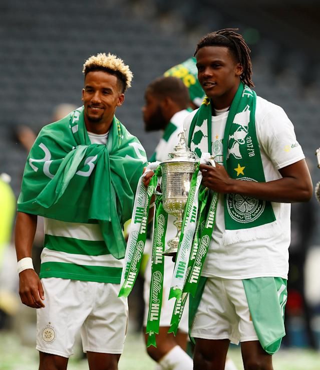 Soccer Football - Scottish Cup Final - Celtic vs Motherwell - Hampden Park, Glasgow, Britain - May 19, 2018 Celtic's Scott Sinclair and Dedryck Boyata celebrate with the trophy after winning the Scottish Cup Action Images via Reuters/Jason Cairnduff