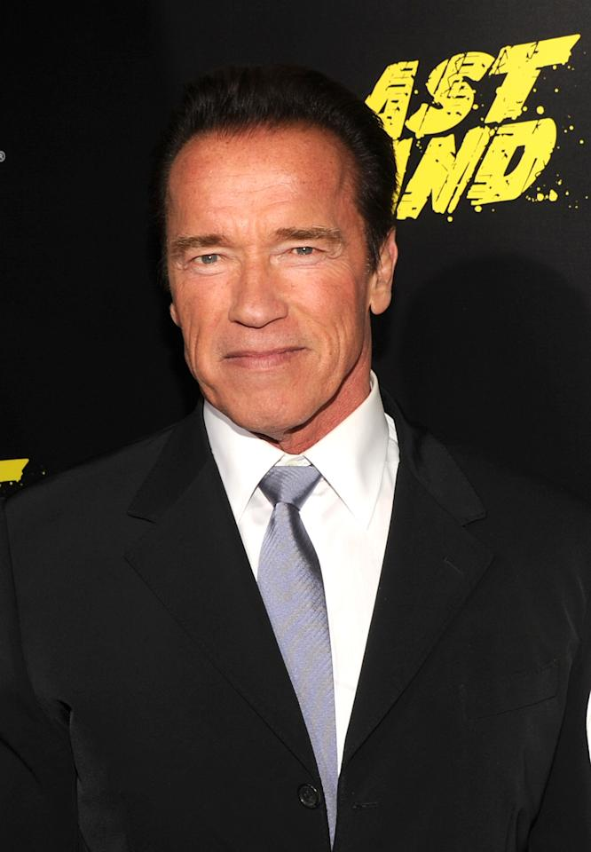 "HOLLYWOOD, CA - JANUARY 14:  Actor Arnold Schwarzenegger arrives at the premiere of Lionsgate Films' ""The Last Stand"" at Grauman's Chinese Theatre on January 14, 2013 in Hollywood, California.  (Photo by Kevin Winter/Getty Images)"