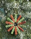 """<p>If they're even a little bit country they'll love this homespun Christmas ornament, crafted from mini clothespins. They make especially sweet teacher gifts, since they're easy enough kids can lend a hand with them.</p><p><strong>To make:</strong> Remove the springs from 14 mini clothespins. Turn the pieces from each clothespin around and glue them back to back. Glue the pins together to create a circular shape. Glue a piece of gold twine to one pin for hanging.</p><p><a class=""""link rapid-noclick-resp"""" href=""""https://www.amazon.com/JABINCO-Wooden-Colored-clothespins-coloers/dp/B0829HX6MQ/ref=sr_1_6?tag=syn-yahoo-20&ascsubtag=%5Bartid%7C10050.g.645%5Bsrc%7Cyahoo-us"""" rel=""""nofollow noopener"""" target=""""_blank"""" data-ylk=""""slk:SHOP MINI CLOTHESPINS"""">SHOP MINI CLOTHESPINS</a></p>"""