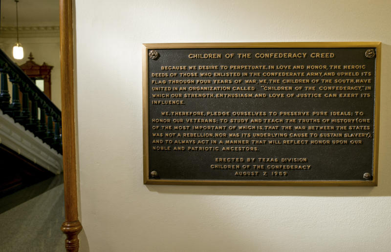 FILE - This Aug. 17, 2017 file photo shows, The Children of the Confederacy Creed plaque at the Capitol in Austin, Texas, on Thursday August 17, 2017. Texas will remove a 60-year-old Confederate plaque in the state Capitol that rejects slavery as an underlying cause of the Civil War. The decision Friday follows years of resistance from state Republican leaders to remove any of the roughly dozen Confederate markers in and around the Texas Capitol. Pressure mounted on Republican Gov. Greg Abbott after a black lawmaker from Dallas began publicly condemning the plaque historically indefensible.(Jay Janner/Austin American-Statesman via AP, File)