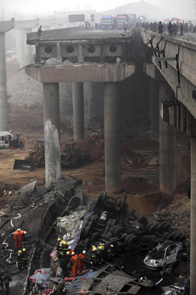 Rescuers work at the accident site where an expressway bridge partially collapsed due to a truck explosion in Mianchi County, Sanmenxia, central China's Henan Province, Thursday, Feb. 1, 2013. Fireworks for Lunar New Year celebrations exploded on a truck in central China, destroying part of an elevated highway Friday and sending vehicles plummeting 30 meters (about 100 feet) to the ground. State media had conflicting reports on casualties. (AP Photo) CHINA OUT