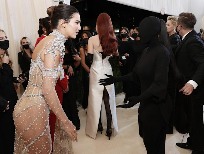 Kendall Jenner and Kim Kardashian West attend The 2021 Met Gala Celebrating In America: A Lexicon Of Fashion