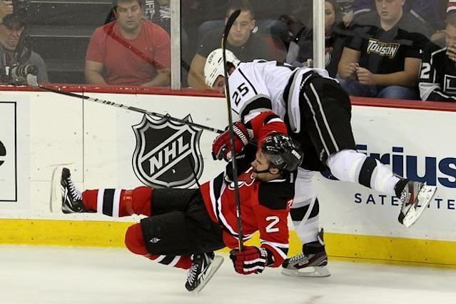 NEWARK, NJ - JUNE 09: Dustin Penner #25 of the Los Angeles Kings collides with Marek Zidlicky #2 of the New Jersey Devils during Game Five of the 2012 NHL Stanley Cup Final at the Prudential Center on June 9, 2012 in Newark, New Jersey. (Photo by Jim McIsaac/Getty Images)
