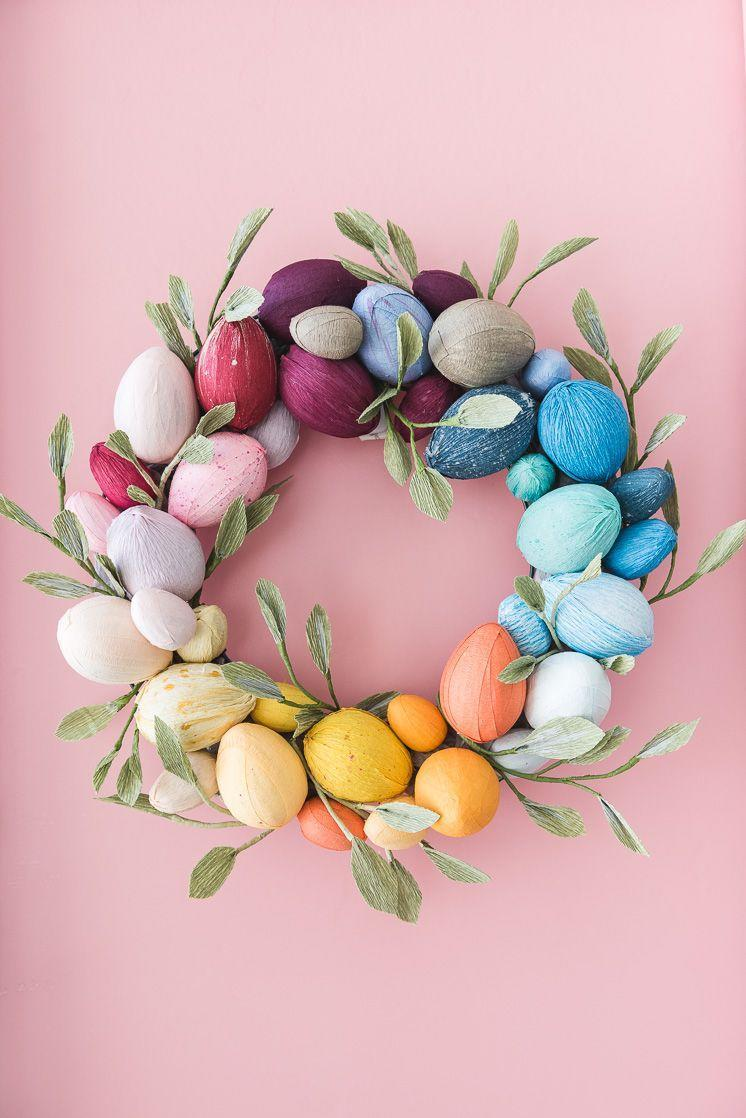 """<p>Papier-mâché eggs mean you can reuse this colorful creation for years to come. Plus, it can do wonders for brightening your curb appeal. </p><p><strong>Get the tutorial at <a href=""""http://thehousethatlarsbuilt.com/2018/02/rainbow-easter-egg-wreath.html/"""" rel=""""nofollow noopener"""" target=""""_blank"""" data-ylk=""""slk:The House That Lars Built"""" class=""""link rapid-noclick-resp"""">The House That Lars Built</a>. </strong></p><p><strong><a class=""""link rapid-noclick-resp"""" href=""""https://www.amazon.com/Bulk-Buy-Darice-Crafts-2833-47/dp/B00KHAZCTW/?tag=syn-yahoo-20&ascsubtag=%5Bartid%7C10050.g.4088%5Bsrc%7Cyahoo-us"""" rel=""""nofollow noopener"""" target=""""_blank"""" data-ylk=""""slk:SHOP EGGS"""">SHOP EGGS</a><br></strong></p>"""