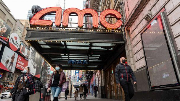 PHOTO: People walk outside the AMC Empire 25 movie theater in Times Square as the city continues the re-opening efforts following restrictions imposed to slow the spread of coronavirus, Dec. 23, 2020, New York. (Noam Galai/Getty Images)