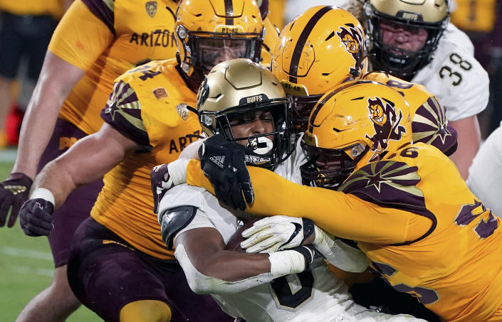 Colorado State tailback Alex Fontenot (8) gets wrapped up by Arizona State defense during the second half of an NCAA college football game Saturday, Sept 25, 2021, in Tempe, Ariz. (AP Photo/Darryl Webb)