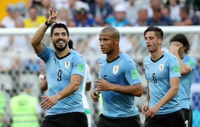 Soccer Football - World Cup - Group A - Uruguay vs Saudi Arabia - Rostov Arena, Rostov-on-Don, Russia - June 20, 2018 Uruguay's Luis Suarez celebrates scoring their first goal with team mates REUTERS/Marko Djurica TPX IMAGES OF THE DAY