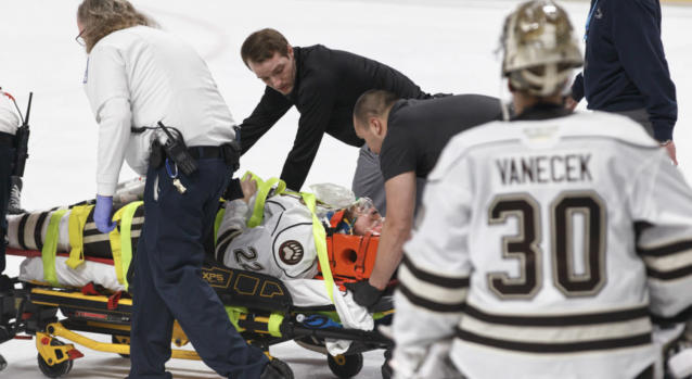 Hershey Bears goaltender Vitek Vanecek looks on as teammate Kale Kessy is stretchered off the ice after being knocked unconscious in a fight on Tuesday night. (Kyle Mace/Chocolate Hockey)