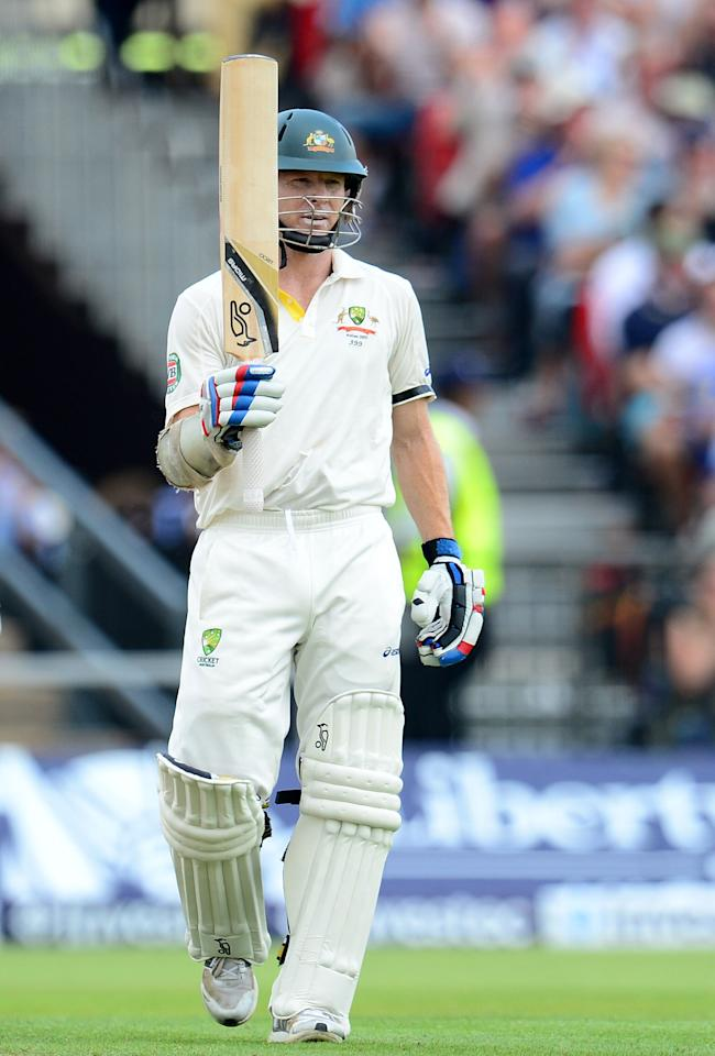 Australia's Chris Rogers celebrates his half century during day one of the Third Investec Ashes test match at Old Trafford Cricket Ground, Manchester.