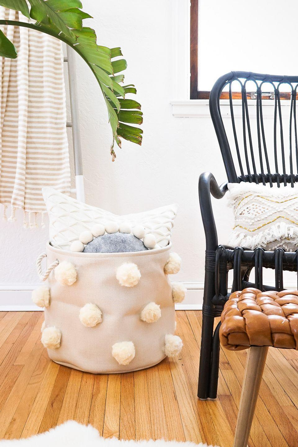 "<p>Keep pillows and throw blankets contained in these adorbs pom pom baskets. Bonus: They could also double as laundry hampers.</p><p>Get the tutorial at <a href=""https://sugarandcloth.com/diy-fluffy-pom-pom-bin/"" rel=""nofollow noopener"" target=""_blank"" data-ylk=""slk:Sugar & Cloth"" class=""link rapid-noclick-resp"">Sugar & Cloth</a>.</p>"