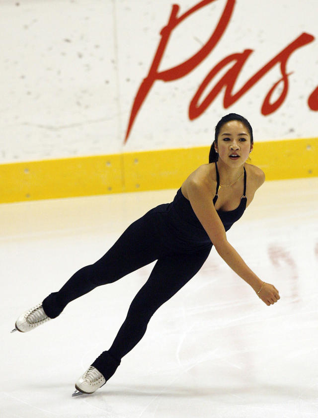 FILE - In this Feb. 11, 2006 file photo, Michelle Kwan, of the United States, skates during practice for the Women's Figure Skating competition at the Turin 2006 Winter Olympic Games in Turin, Italy. On Monday, March 7, 2014, Kwan was to be surrounded by more than a dozen of her fellow champions and honored by the unique Figure Skating in Harlem, a program for which she has provided inspiration for 16 years. (AP Photo/Kevork Djansezian, File)