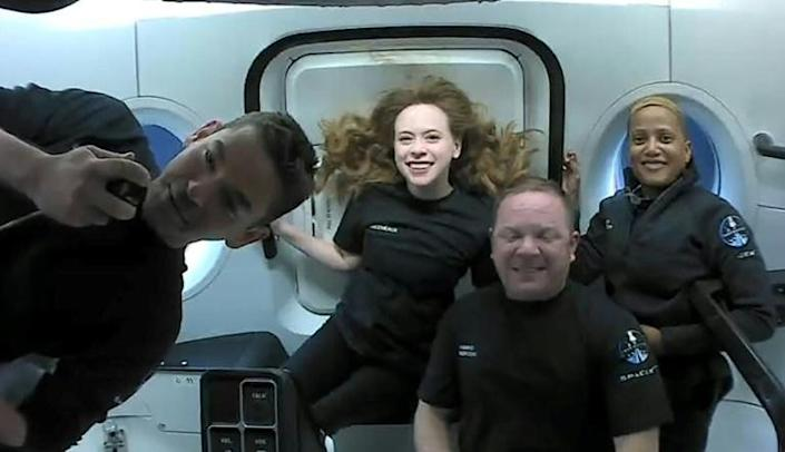 This September 16, 2021, image courtesy of Inspiration4 shows the crew (L-R) Jared Isaacman, Hayley Arceneaux, Christopher Sembroski and Sian Proctor in orbit (AFP/Handout)
