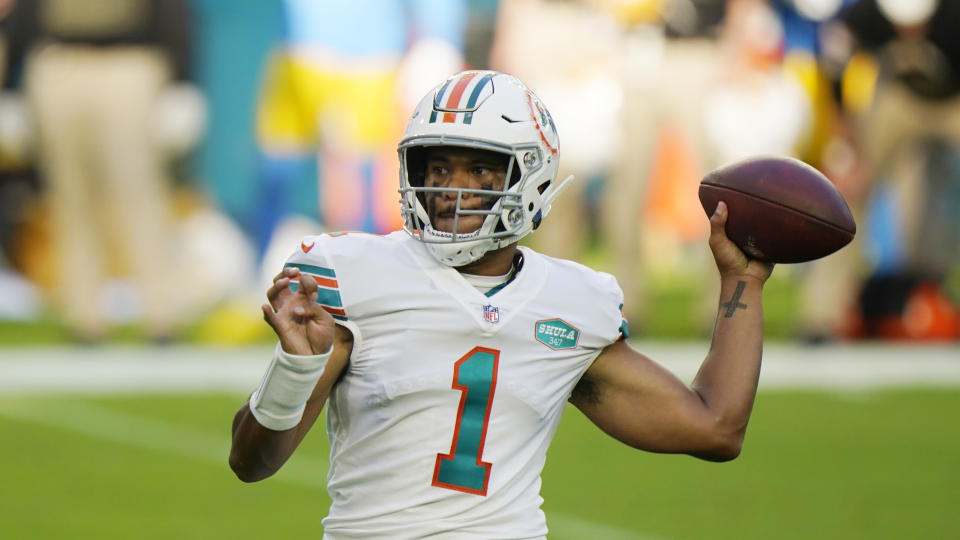 Miami Dolphins quarterback Tua Tagovailoa (1) looks to pass, during the first half of an NFL football game against the Los Angeles Chargers, Sunday, Nov. 15, 2020, in Miami Gardens, Fla. (AP Photo/Wilfredo Lee)