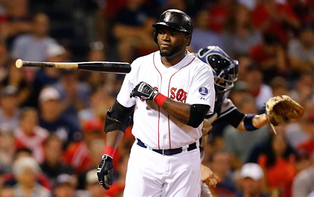 BOSTON, MA - JULY 21: David Ortiz #34 of the Boston Red Sox throws his bat after being walked by the New York Yankees during the game on July 21, 2013 at Fenway Park in Boston, Massachusetts. (Photo by Jared Wickerham/Getty Images)