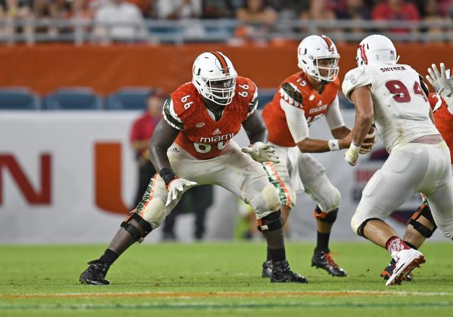 "<a class=""link rapid-noclick-resp"" href=""/ncaaf/players/225694/"" data-ylk=""slk:Sunny Odogwu"">Sunny Odogwu</a> started 14 games during his time at Miami. (Photo by Richard C. Lewis/Icon Sportswire via Getty Images)"