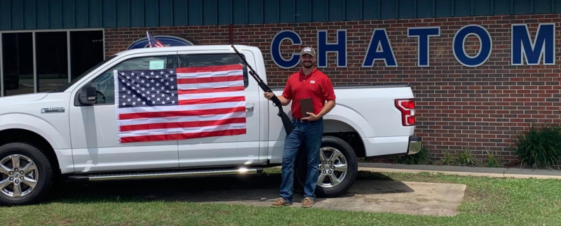 Chatom Ford in Alabama is giving away a free bible, American flag, and 12 gauge shotgun to anyone who purchases a new or preowned car from now until July 31. (Photo: Facebook)