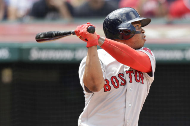 Boston Red Sox's Rafael Devers watches his ball after hitting a solo home run in the third inning in a baseball game against the Cleveland Indians, Wednesday, Aug. 14, 2019, in Cleveland. (AP Photo/Tony Dejak)