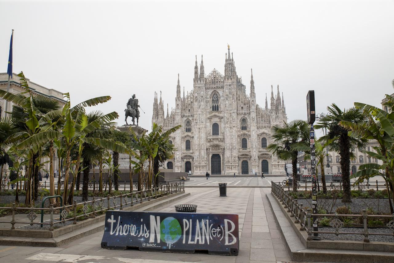 "An environmental protest banner, reading ""there is no plan(et) B"" sits on the edge of an empty Duomo square in view of Duomo Cathedral, in Milan, Italy, on March 10, 2020. (Credit: Camilla Cerea/Bloomberg)"