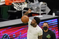 Boston Celtics' Marcus Smart dunks as he warms up before an NBA basketball game against the LA Clippers, Tuesday, March 2, 2021, in Boston. Smart has been out of action for over a month with a torn left calf muscle. While there is no exact date for Smart's anticipated return, it should be some time just after the upcoming All-Star break, according to team officials. (AP Photo/Elise Amendola)