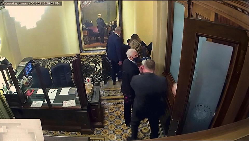 Security video shows Vice President Mike Pence being evacuated as rioters breach the Capitol (AP)