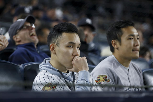 Fans watch during the ninth inning in Game 4 of baseball's American League Championship Series between the Houston Astros and the New York Yankees Friday, Oct. 18, 2019, in New York. (AP Photo/Matt Slocum)