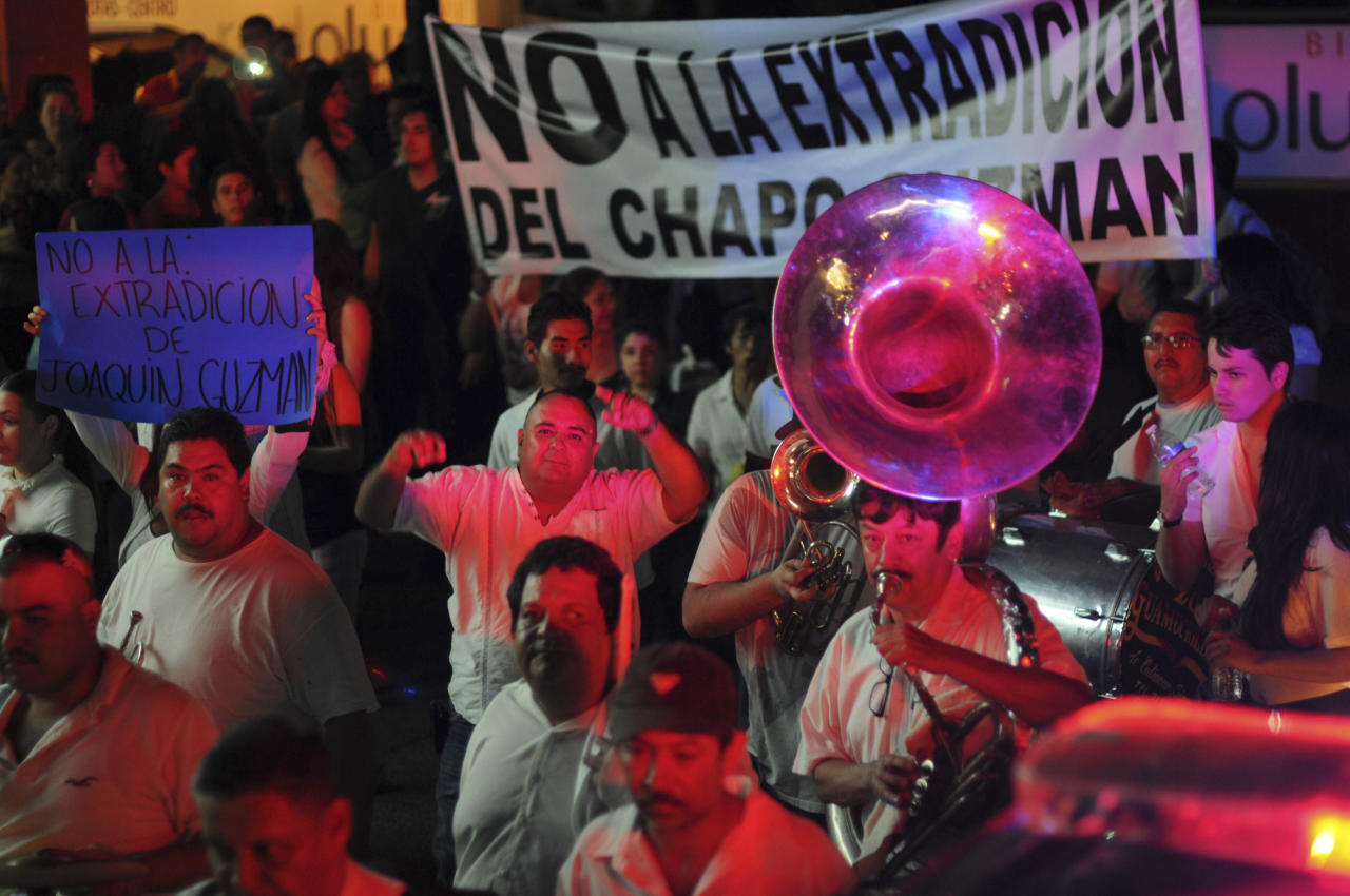 "People play music and march in support of jailed top drug boss Joaquin Guzman Loera, ""El Chapo"" in the city of Culiacan, Mexico, Wednesday Feb. 26, 2014. Hundreds of people marched on the streets of Culiacan, the drug lord's bastion, demanding that Guzman be freed, before they briefly clashed with police who fired tear gas at them. The Sign says"" No to the extradition of Chapo Guzman""(AP Photo/El Debate de Culiacan-Jonathan Telles)"