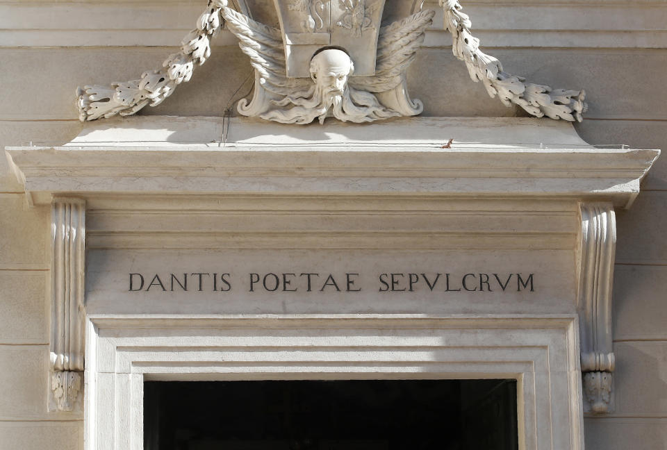 The entrance of poet Dante Alighieri's tomb, in Ravenna, Italy, Saturday, May 8, 2021. Italy is honoring its great poet in myriad ways on the 700th anniversary of his death, with new musical scores and gala concerts, exhibits and dramatic readings against stunning backgrounds in every corner of the land. (AP Photo/Antonio Calanni)
