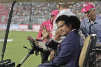 Former Indian cricketer Sachin Tendulkar acknowledges the crowd during a grand parade of India's former cricket captains during the first day of the second test match between India and Bangladesh, in Kolkata, India, Friday, Nov. 22, 2019. (AP Photo/Bikas Das)