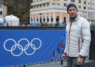 Norway's Aksel Lund Svindal takes a walk through the streets of the Rosa Khutor ski resort in Krasnaya Polyana, Russia at the Sochi 2014 Winter Olympics, Monday, Feb. 17, 2014. Svindal is leaving the Olympics because he has problems with allergies and fatigue, the Norwegian men's Alpine skiing coach said Monday. (AP Photo/Christophe Ena)