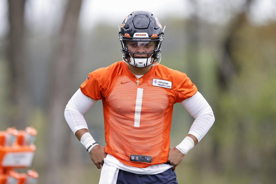 Justin Fields could be the QB savior Chicago Bears fans have longed for. But he'll have to wait to play, and here's why. (Kamil Krzaczynski-USA TODAY Sports)