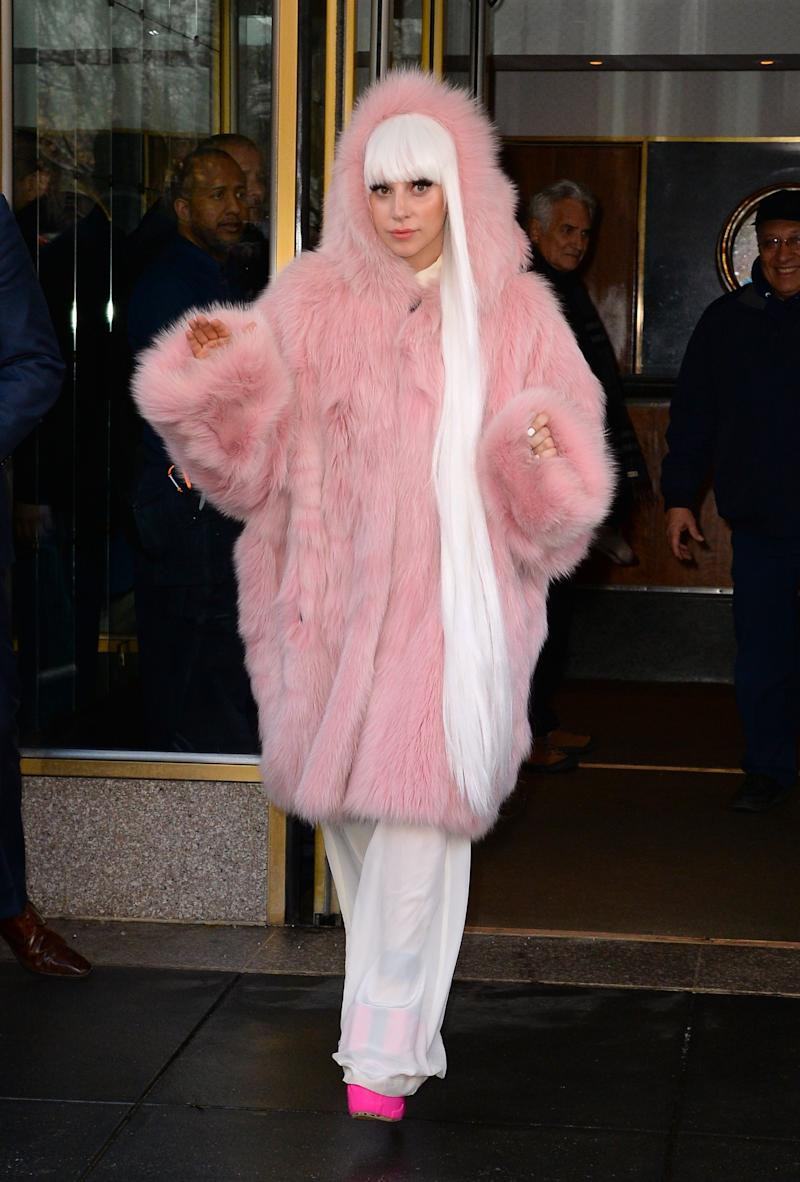 Sporting ultra long white-blond locks and a pink fur coat leaving her apartment in New York.